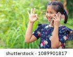 little girl using smartphone to ... | Shutterstock . vector #1089901817