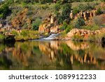 reflection of rocks in the... | Shutterstock . vector #1089912233