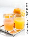 fresh citrus juices in glasses  ... | Shutterstock . vector #1089942677