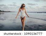 graceful girl looking at sea... | Shutterstock . vector #1090136777