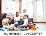 happy asian family planning... | Shutterstock . vector #1090209467