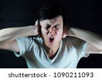 asian man closes his ears from... | Shutterstock . vector #1090211093