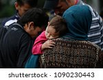 a family of refugees rest in...   Shutterstock . vector #1090230443