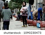 a family of refugees rest in...   Shutterstock . vector #1090230473