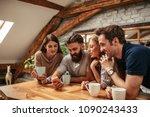a group of friends drinking... | Shutterstock . vector #1090243433