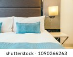 white pillow on the bed... | Shutterstock . vector #1090266263