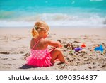 little girl play with sand on... | Shutterstock . vector #1090354637