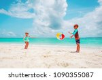 little girl and boy play ball... | Shutterstock . vector #1090355087