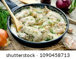 Small photo of Gedlibzhe — kabardian chicken in sour cream sauce with onion garlic and spices in a frying pan close up