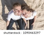 a happy young couple of... | Shutterstock . vector #1090463297