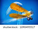 sports plane against a blue sky | Shutterstock . vector #1090495517