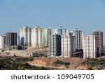 panoramic view to modern buildings under construction - stock photo