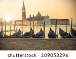 San Giorgio Maggiore island in Venice at sunset - gondolas on foreground - stock photo