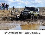 "MONCHEGORSK, RUSSIA - JULY 15: Unidentified racer at off-road car steep slope in the ""OFF-ROAD SHOW 2012"" on July 15, 2012 in Monchegorsk (Murmansk region), Russia - stock photo"