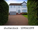 Typical 1930s white detached house with Bay Window and large driveway, in Bristol, England - stock photo