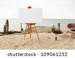 Easel ready for painting, standing in a empty beach - stock photo