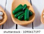 medicament pills on bamboo...   Shutterstock . vector #1090617197