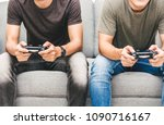 two friends sitting on sofa and ... | Shutterstock . vector #1090716167