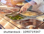 chef standing behind full lunch ... | Shutterstock . vector #1090719347