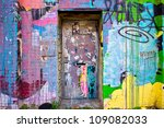 BROOKLYN, NY - JUNE 28:  Graffiti covered door in Williamsburg Brooklyn NYC on June 28, 2012. The popular and culturally exciting neighborhood has become a place for emerging hipster street artists. - stock photo