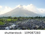 The Mayon Volcano - active volcano rising 2,462 metres,  known as the  most perfectly cone-shaped volcano.Location on  Luzon island, Philippines - stock photo