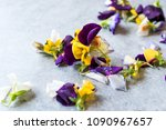 edible flowers on blue surface... | Shutterstock . vector #1090967657
