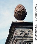 Small photo of Decorative cone and ornament of an ancient temple
