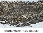 Old Stone Wall Of Snow Covered
