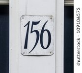 house number hundred and fifty-six, hand painted on a metal plate - stock photo
