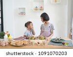 two little girl cooks in the... | Shutterstock . vector #1091070203