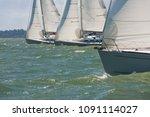 three sailing boats sailboats... | Shutterstock . vector #1091114027