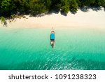 long tail boat on the beach... | Shutterstock . vector #1091238323
