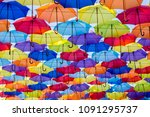 colorful umbrellas background.... | Shutterstock . vector #1091295737