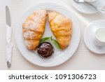croissants with chocolate.... | Shutterstock . vector #1091306723