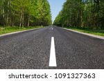 narrow  two lane paved road... | Shutterstock . vector #1091327363
