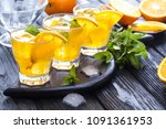 orange cocktail with ice and... | Shutterstock . vector #1091361953