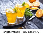 orange cocktail with ice and... | Shutterstock . vector #1091361977