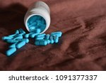 blue medications are scattered... | Shutterstock . vector #1091377337