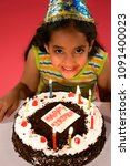 a girl with her birthday cake | Shutterstock . vector #1091400023