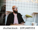 young hipster man blogger in... | Shutterstock . vector #1091485553