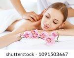 a beautiful girl enjoys massage ... | Shutterstock . vector #1091503667