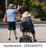 unknown caregiver is helping a... | Shutterstock . vector #1091603573