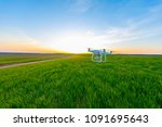 drone quad copter on green corn ... | Shutterstock . vector #1091695643