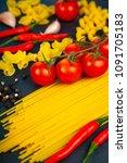 different pasta on a dark ...   Shutterstock . vector #1091705183