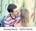 young couple kissing near... | Shutterstock . vector #109176143
