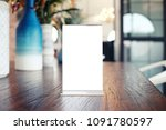 menu frame standing on wood... | Shutterstock . vector #1091780597