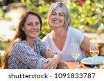 portrait of two beautiful women ... | Shutterstock . vector #1091833787