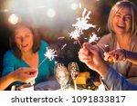 one summer evening  friends in... | Shutterstock . vector #1091833817