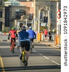 Small photo of CARDIFF BAY, CARDIFF, WALES - MAY 2018: Cyclists crossing the Cardiff Bay barrage. The development of the barrage created a new cycling route which is popular all year round.