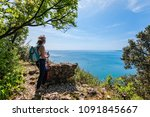 mature hiker female with... | Shutterstock . vector #1091845667